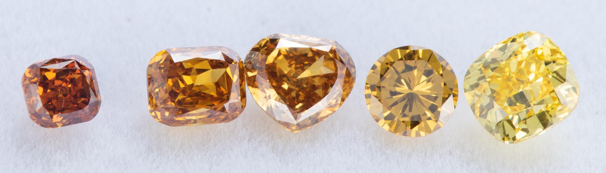 ファンシーカラーダイヤモンドグラデーション写真イエロウィッシュオレンジからビビッドイエローまで フェイスアップ
